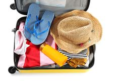Packed suitcase with summer clothes and accessories. On white background stock photo
