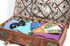 Packed suitcase for a summer vacation Stock Photo