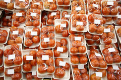 Packed tomatoes. In the supermarket Stock Photo