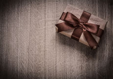 Packed vintage present box on wooden board holiday concept copys Royalty Free Stock Images