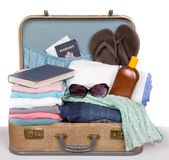 Packed vintage suitcase. Full of vacation items Stock Photos
