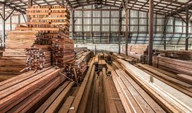 Packed warehouse with wood Stock Image