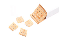 A packet of biscuits and one broken isolated on white background Stock Image