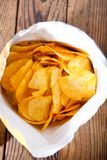 Packet of chips. Food background. potato chips.Top view. Mock up. Copy space.Template. Blank. Packet of chips. Food background. potato chips.Top view. Mock up royalty free stock images