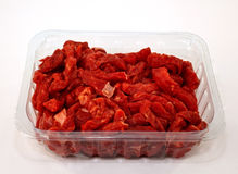Packet of chopped red meat Stock Images