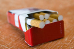 Packet of cigarettes. Closeup of open packet of cigarettes Royalty Free Stock Photo