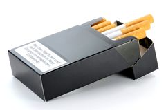 Packet of cigarettes. With German warning: smoking seriously harms you and others around to considerable damage Royalty Free Stock Photo
