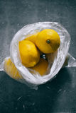 A packet of citrus. Lemons on a gray background Stock Photography
