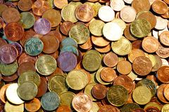 A packet of euro cent coins. A whole stack and packet of different euro cent coins royalty free stock photography