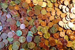 A packet of euro cent coins. A whole stack and packet of different euro cent coins stock photo