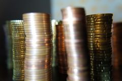 A packet of euro cent coins. A whole stack and packet of different euro cent coins stock photos