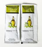 Packets of Canola and Olive Oil condiments. Packets of Olive Oil from a fast food restaurant Stock Image
