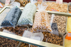 Packets of dried beans on counter in Paris market Royalty Free Stock Images