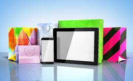 Packets next to the phone and tablet on glass flor 3d render on Royalty Free Stock Image