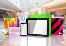 Packets next to the phone and tablet on glass flor 3d render Stock Photography