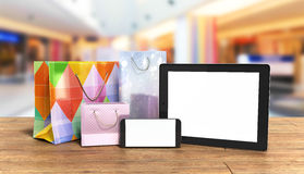 Packets next to the phone and tablet on wooden flor 3d illustrat Royalty Free Stock Photos