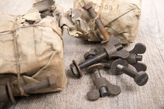 Packets old bolts Stock Images