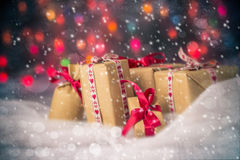 Packets presents Christmas background colored lights gift snow s Stock Photo