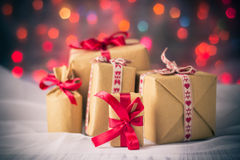 Packets presents Christmas background colored lights gift Royalty Free Stock Image