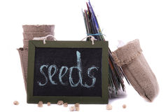 Packets of seeds, peat pots and a wooden plaque with the inscrip Stock Photo