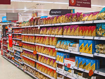 Packets of spaghetti in a superstore. Packets of spaghetti on shelves to purcase in a supermarket. this is in the Sainsbury supermarket in Bedford, England Royalty Free Stock Images