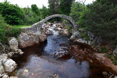 The Packhorse Bridge in Carrbridge is the oldest stone bridge in the Scottish Highlands.  Stock Photography
