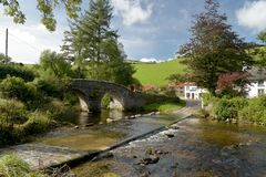 Packhorse bridge and ford at Malmsmead, Exmoor, North Devon. Picturesque packhorse bridge and ford through Badgworthy Water at Malmsmead, Exmoor, North Devon Stock Photography