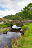 Packhorse bridge Lake District Cumbria England UK. Packhorse bridge Watendlath Tarn Lake District Cumbria England between the Borrowdale and Thirlmere valleys Royalty Free Stock Photo