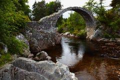 Packhorse Bridge. Old stone Packhorse Bridge over the river Dulnain in Carrbridge, Scotland Stock Photo