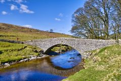 Packhorse bridge over river Stock Photos