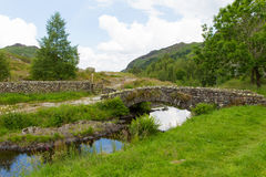 Packhorse bridge Watendlath Tarn Lake District Cumbria England UK. Packhorse bridge Watendlath Tarn Lake District Cumbria England between the Borrowdale and Royalty Free Stock Images