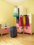 Packing. Suitcase, dresses and packing for a holiday Royalty Free Stock Image