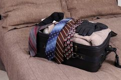 Packing. A suitcase being packed on a bed Stock Photos