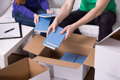 Packing books into boxes Stock Photos