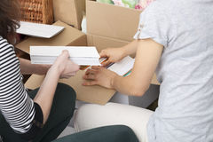 Packing books Stock Photo