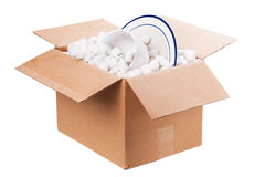 Packing box. An isolated box with styrofoam and dishes royalty free stock photos