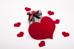 Packing box and many hearts. Packing box in the middle of the hearts Royalty Free Stock Photography