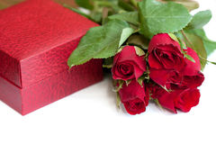 Packing box and red roses Royalty Free Stock Photo