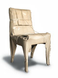 Packing chair. With brown crumpled paper  isolated Stock Images