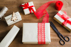 Packing Christmas Gifts. Top View of Festive Boxes on Wooden Table. Selective Focus. Royalty Free Stock Photo