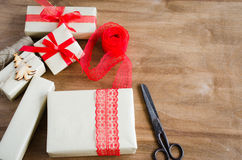 Packing Christmas Gifts. Top View of Festive Boxes on Wooden Table. Selective Focus. Royalty Free Stock Photos