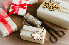 Packing Christmas Gifts. Top View of Festive Boxes on Wooden Table. Selective Focus. Stock Images