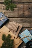 Packing christmas gifts in vintage beige blue roll paper on old wooden desk. Top View. Flat Lay. Copy space. royalty free stock photo