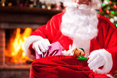 Packing Christmas presents. Stock Image