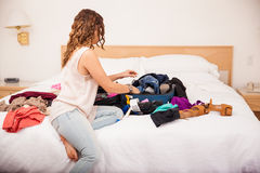 Packing clothes at a hotel Stock Image