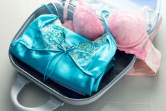 Packing clothes into travel bag. Luggage and people concept Royalty Free Stock Image