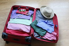 Packing clothing up preparatory to travelling. Packing clothing up preparatory to her journey Royalty Free Stock Photos