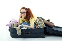 Packing and dreaming about a journey. Royalty Free Stock Photo