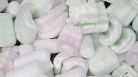 Packing foam close up. Many soft packing foam pieces close up background, diagonal sliding camera motion stock video footage
