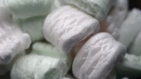 Packing foam rotating. Different packing foam pieces rotating closeup background stock video